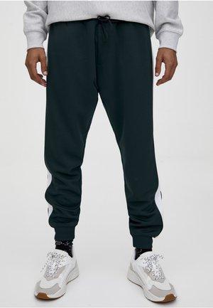 JOGGINGHOSE MIT FARBLICH ABGESETZTEM SEITENSTREIFEN 09670509 - Spodnie treningowe - dark green