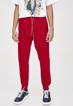 MIT ROTEM STREIFEN - Spodnie treningowe - light red