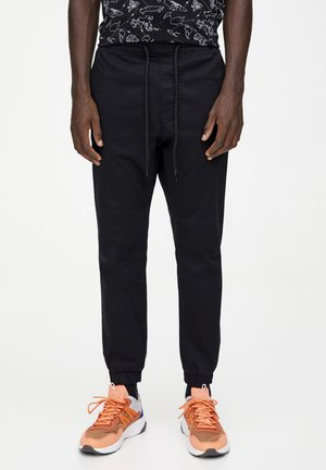 Spodnie treningowe - mottled black