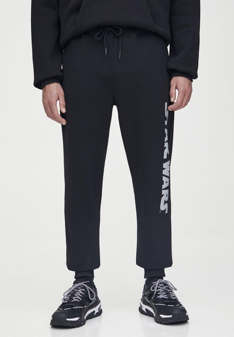PULL&BEAR - STAR WARS  - Pantaloni sportivi - black