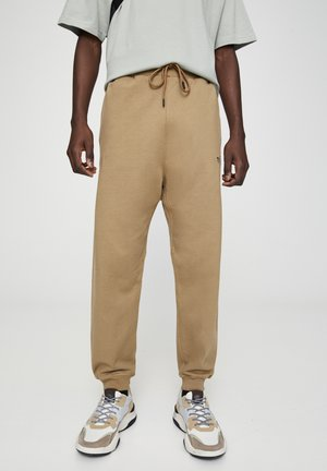 BASIC - Tracksuit bottoms - brown