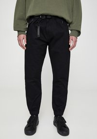 PULL&BEAR - Trousers - metallic black - 0