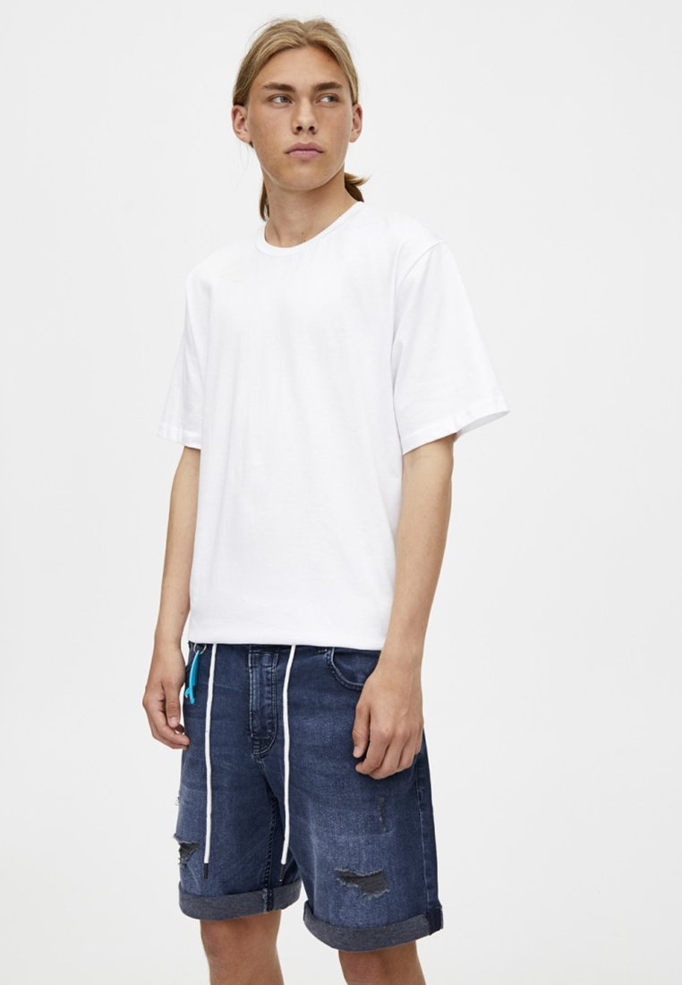 PULL&BEAR - MIT RISSEN  - Denim shorts - dark-blue denim