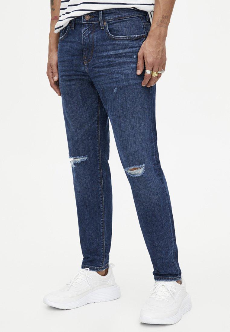 PULL&BEAR - MIT RISSEN - Jeans Skinny Fit - dark blue