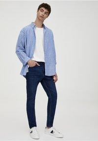 PULL&BEAR - Slim fit jeans - dark blue denim - 1