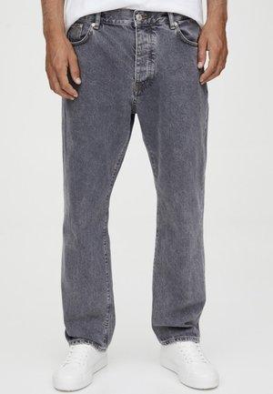 MIT SCHLITZ - Straight leg jeans - black