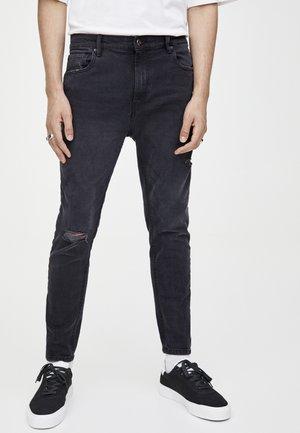 MIT RISSEN  - Slim fit jeans - black