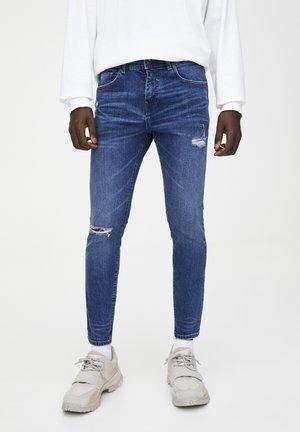 MIT RISSEN  - Jeans slim fit - royal blue