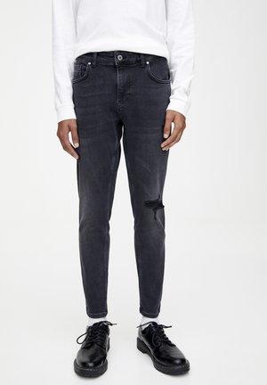 MIT RISSEN - Jeans Skinny - black