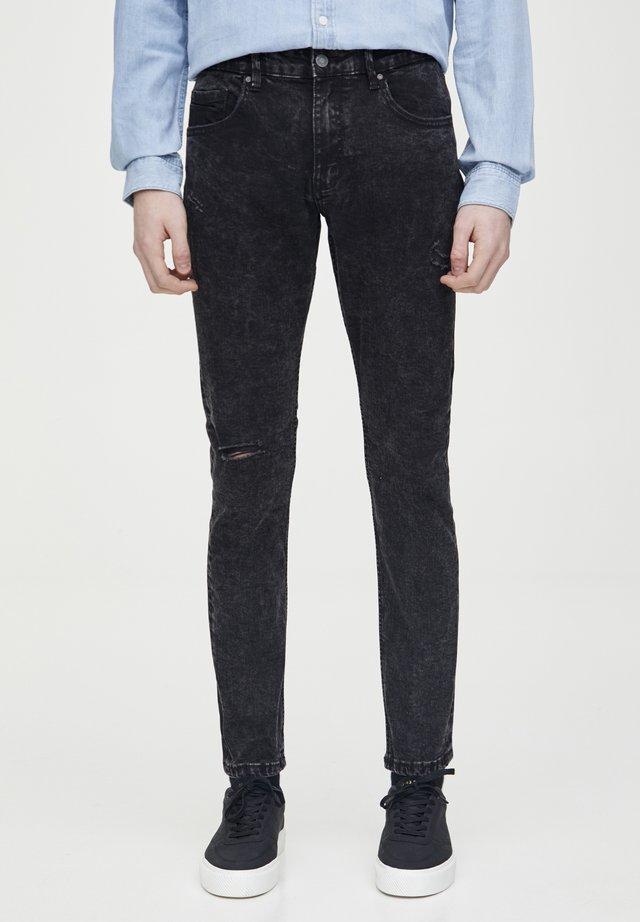 SCHWARZE SUPER-SKINNY-FIT-JEANS MIT ZIERRISSEN 05682540 - Jeans slim fit - dark grey