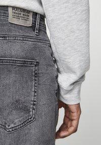 PULL&BEAR - PREMIUM-KAROTTENJEANS MIT ZIERRISSEN 05684525 - Slim fit jeans - dark grey - 3
