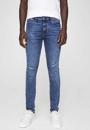 SUPERSKINNY-FIT-JEANS MIT ZIERRISSEN 05682532 - Slim fit jeans - dark blue