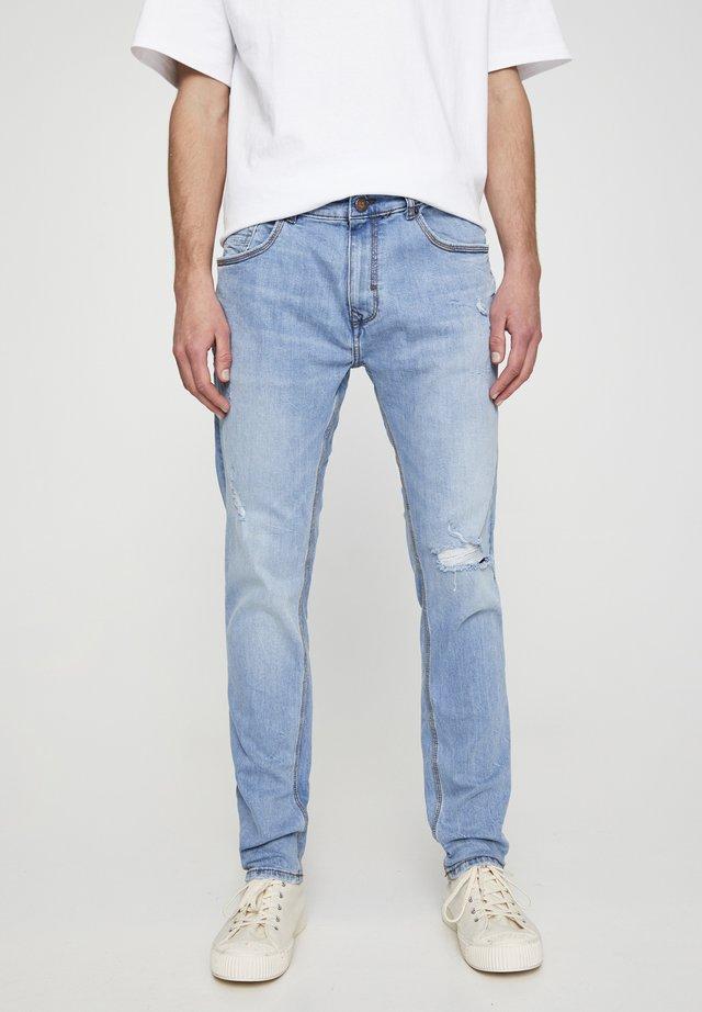 MIT ZIERRISSEN - Jeans slim fit - blue