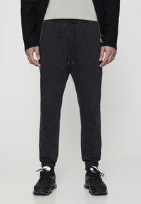 PULL&BEAR - MIT STRETCHBUND  - Jeans Tapered Fit - mottled dark grey - 0
