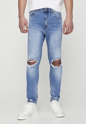 MIT ZIERRISSEN  - Slim fit jeans - light blue