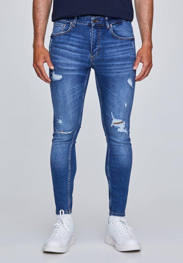 Skinny džíny - dark-blue denim