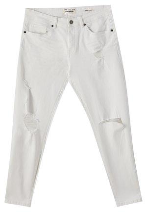 MIT ZIERRISSEN - Jeans Skinny - white