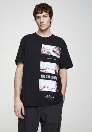 DIE ERSCHAFFUNG ADAMS - T-shirt imprimé - black