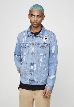 MIT MEHREREN RISSEN  - Denim jacket - mottled blue