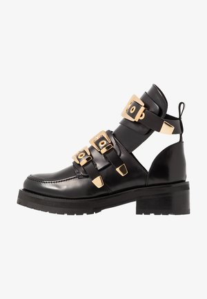 KAJA POLIDO - Ankle boots - black/gold