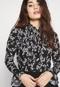 Miss Selfridge Petite - SHIRRED HIGH NECK - Long sleeved top - black - 4
