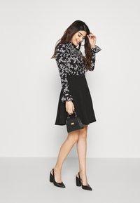 Miss Selfridge Petite - SHIRRED HIGH NECK - Long sleeved top - black - 1