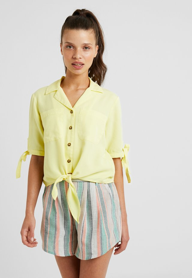 POCKET TIE FRONT PLAIN - Button-down blouse - lemon