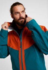 PYUA - GORGE - Snowboard jacket - rusty orange/petrol blue - 3
