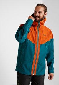 PYUA - GORGE - Snowboard jacket - rusty orange/petrol blue - 0