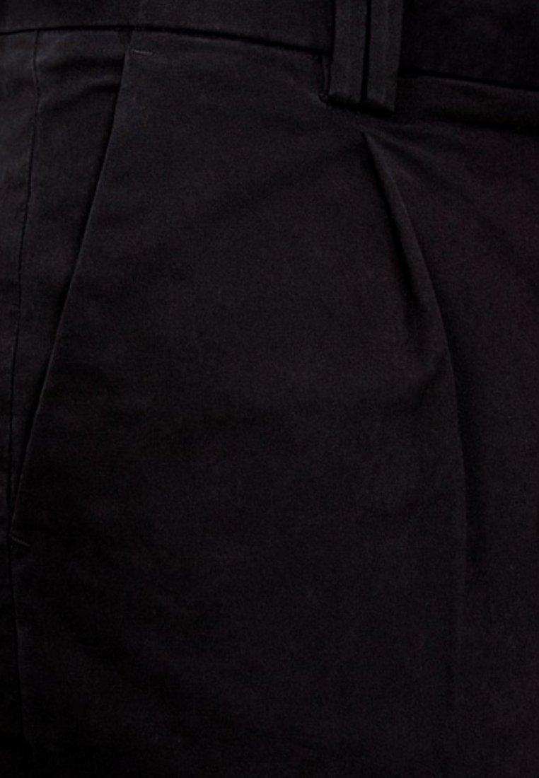Produkt Tygbyxor - black