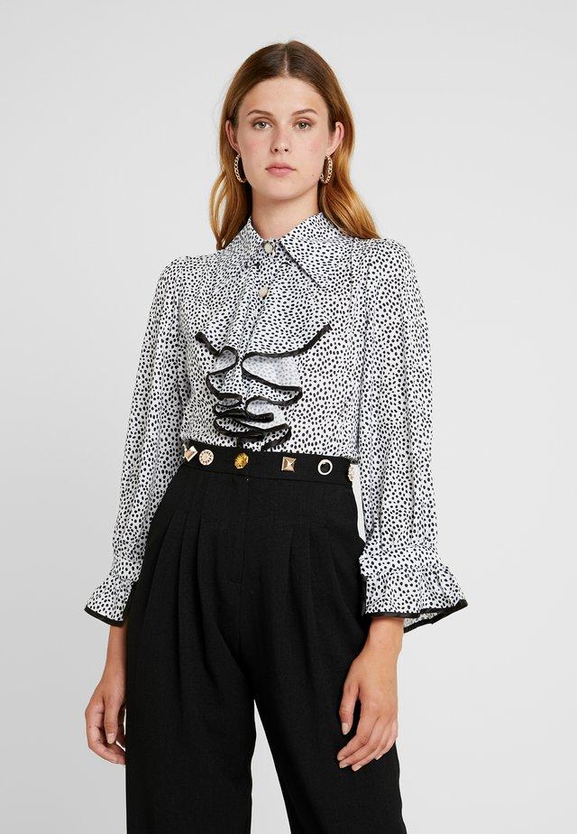 POLKA RUFFLE BLOUSE - Button-down blouse - black/white