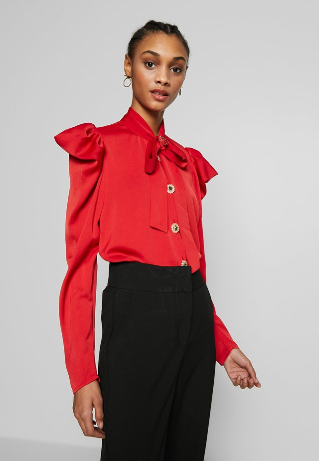 CRIMSON BOW - Button-down blouse - red
