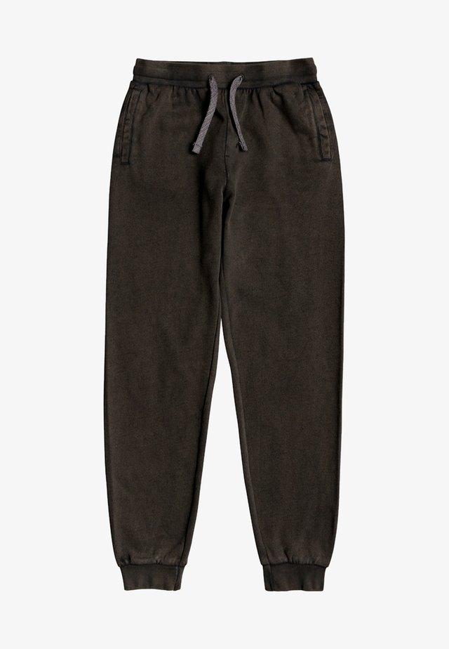 WILD CHOP - Tracksuit bottoms - black
