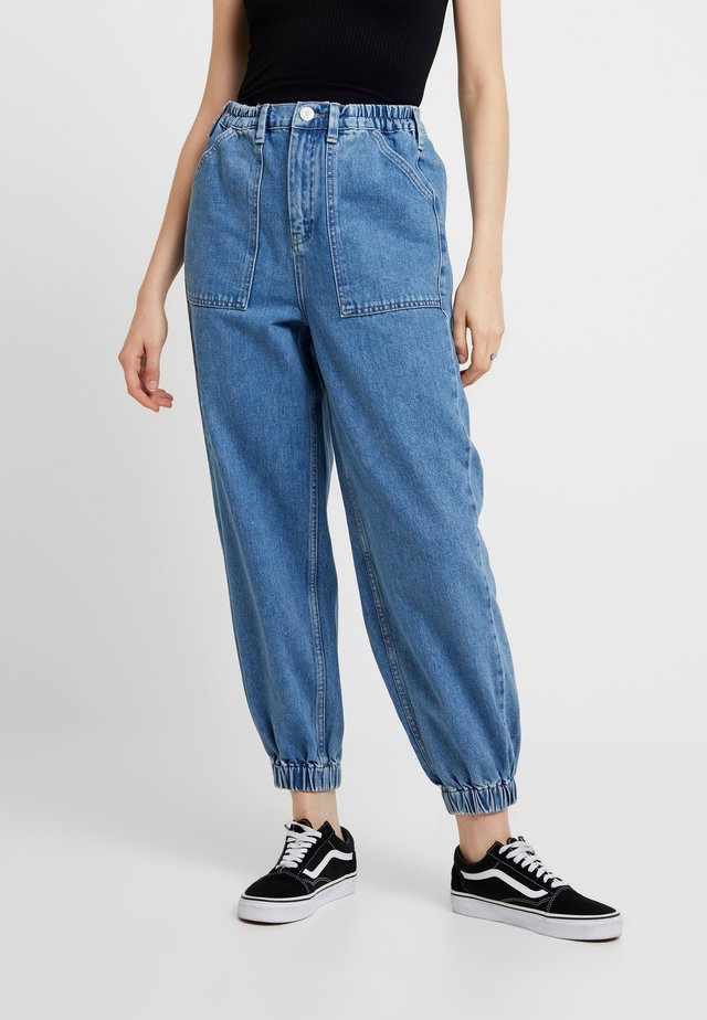 LUCA TROUSER - Jeans Tapered Fit - denim