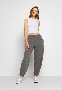 BDG Urban Outfitters - Tracksuit bottoms - charcoal - 1