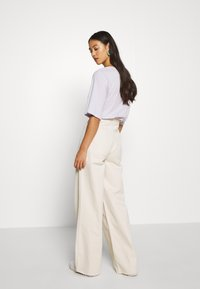 BDG Urban Outfitters - CORSET  - Flared Jeans - ecru - 2