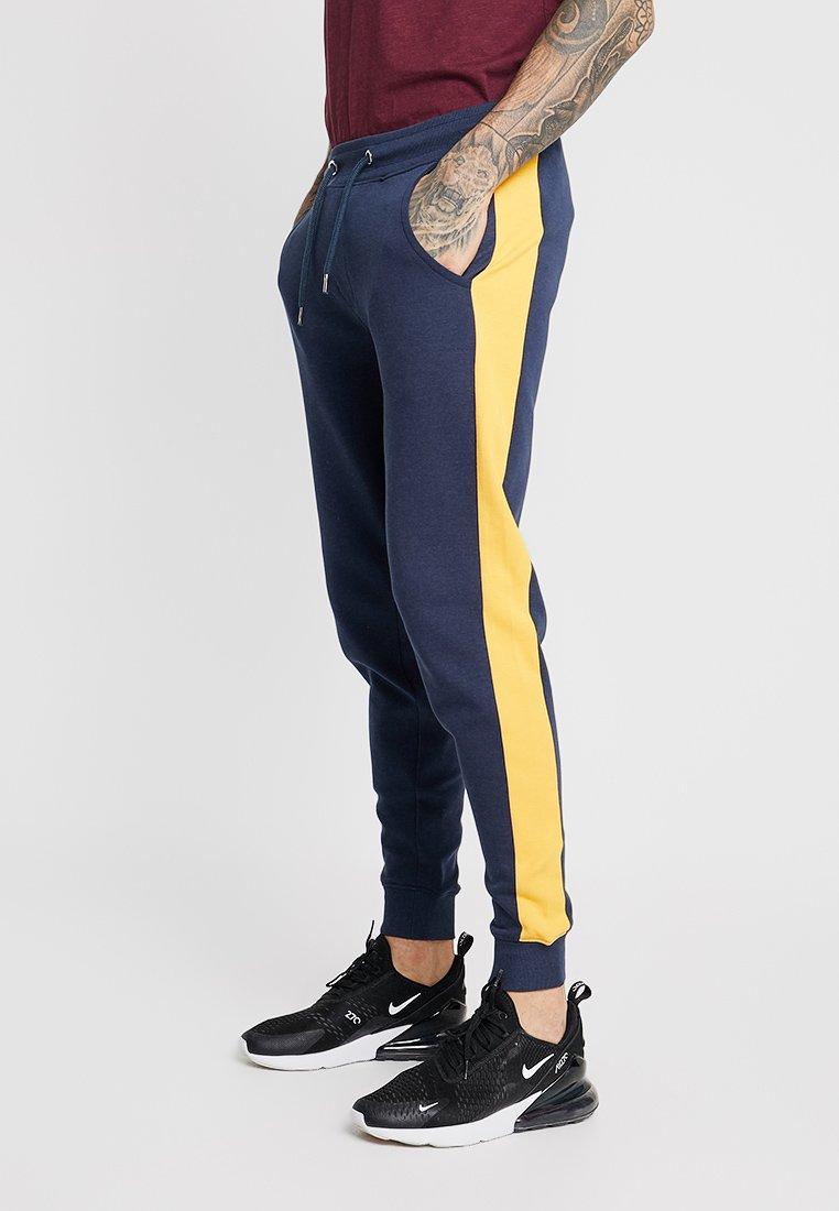 Redefined Rebel - SAMUEL PANTS - Pantalon de survêtement - navy