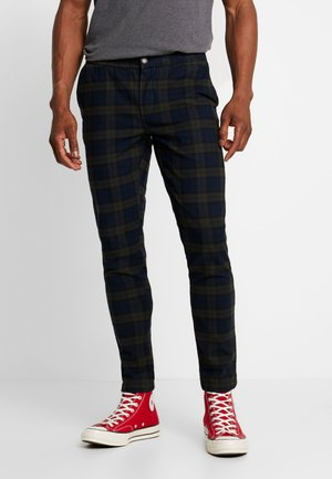 KING PANTS - Kangashousut - dark olive check