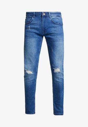 STOCKHOLM - Skinny džíny - dark indigo
