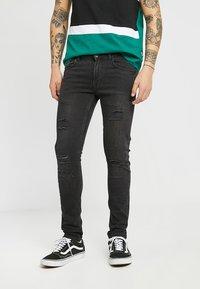 Redefined Rebel - STOCKHOLM - Jeans Skinny Fit - black - 0