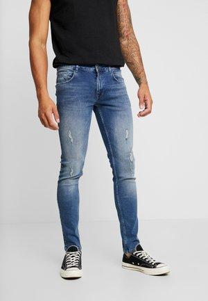 STOCKHOLM DESTROY - Slim fit jeans - authentic indigo