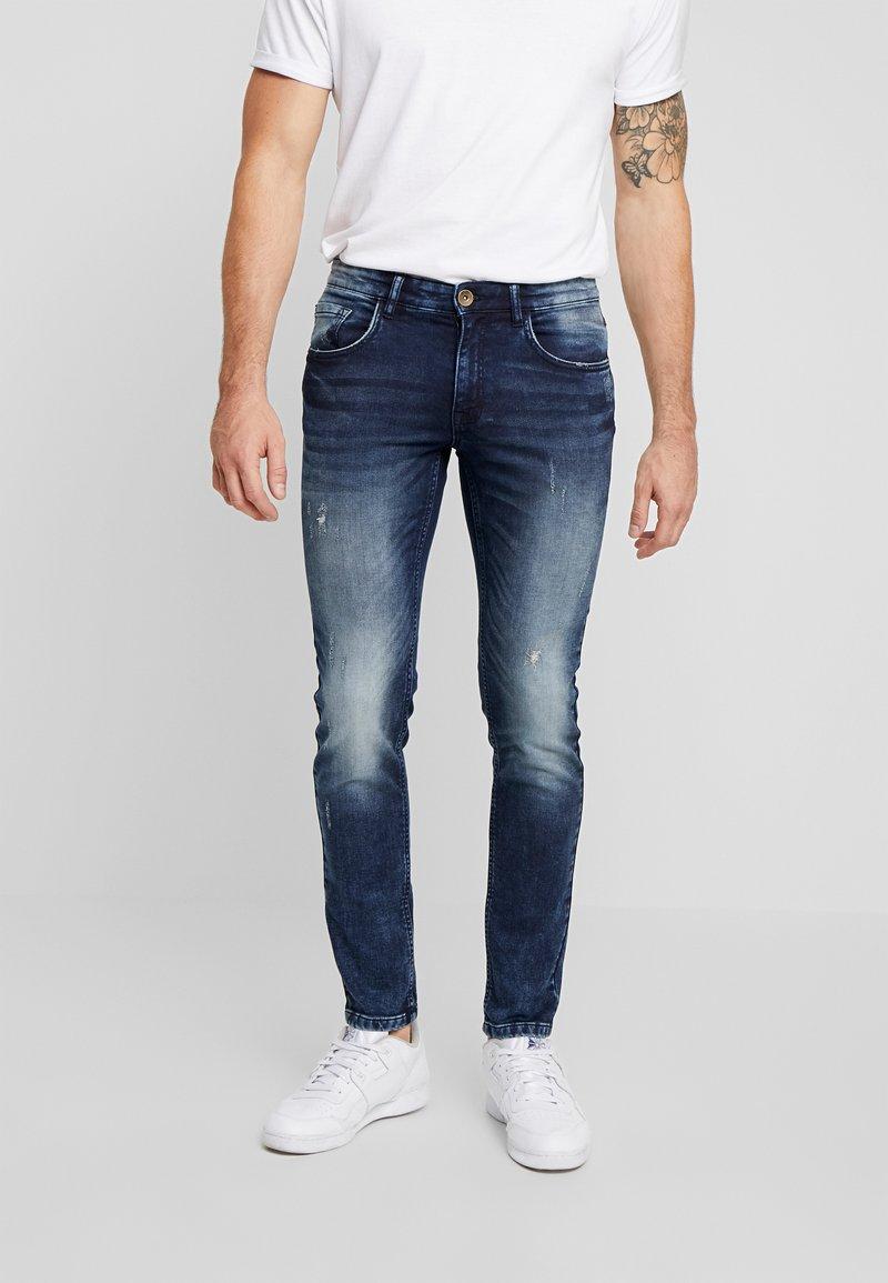Redefined Rebel - STOCKHOLM TERRY - Slim fit jeans - dark sea