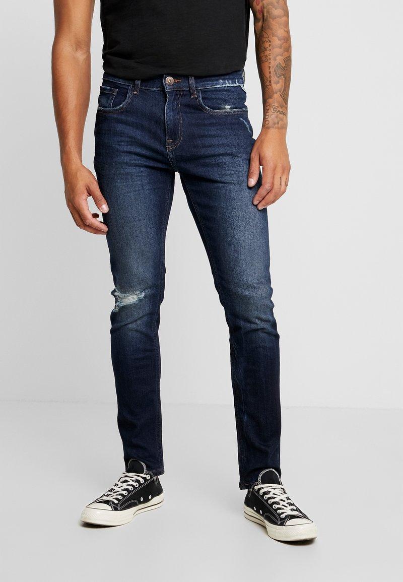 Redefined Rebel - MILANO DESTROY - Slim fit jeans - deep indigo