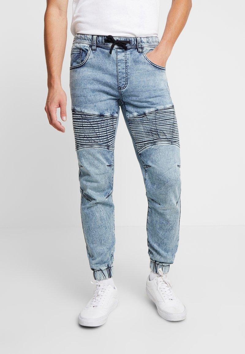 Redefined Rebel - RRROMA BIKER - Spodnie treningowe - light blue