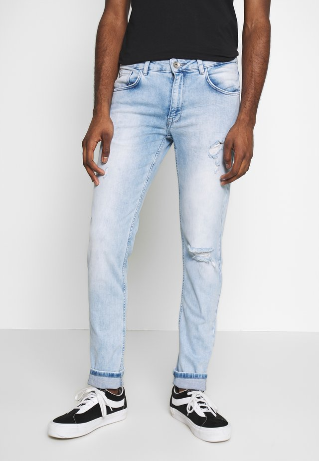 STOCKHOLM DESTROY - Jeans Skinny Fit - cool blue
