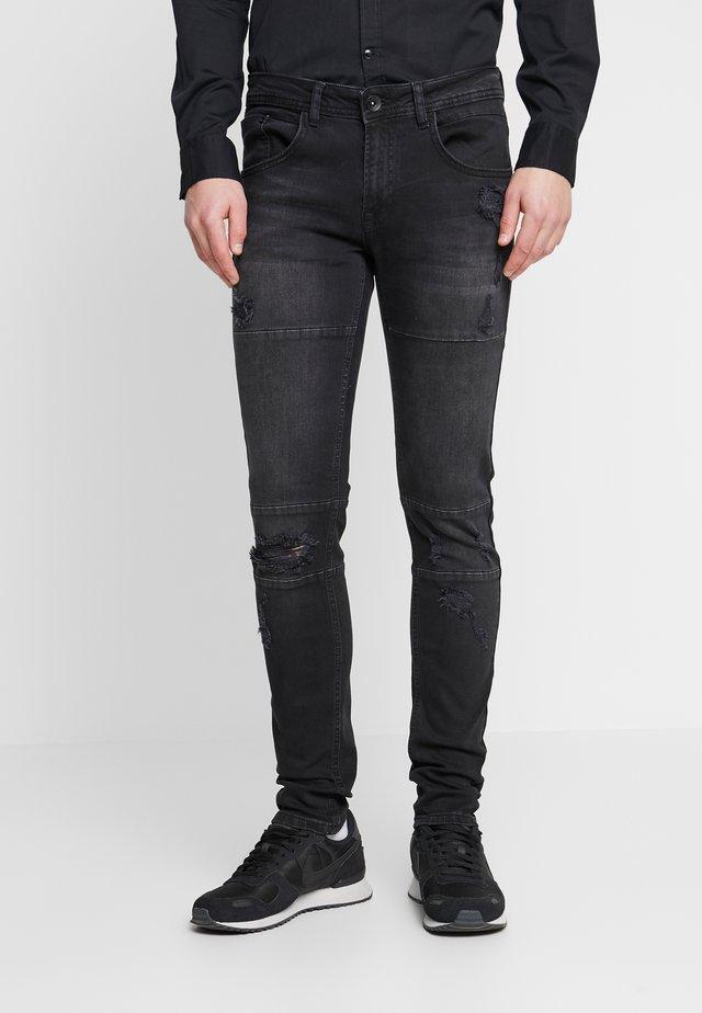 STOCKHOLM CUT DESTROY - Jeans Skinny Fit - black