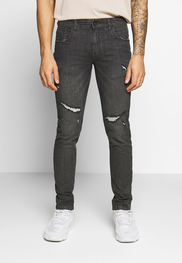STOCKHOLM DESTROY - Jeans Skinny Fit - vintage black