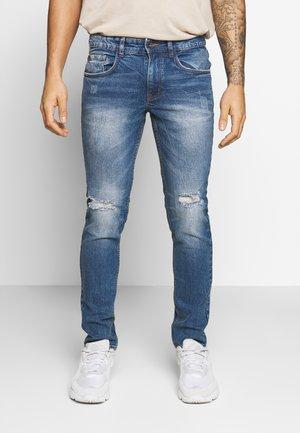RRSTOCKHOLM DESTROY - Jeans Skinny Fit - perfect indigo
