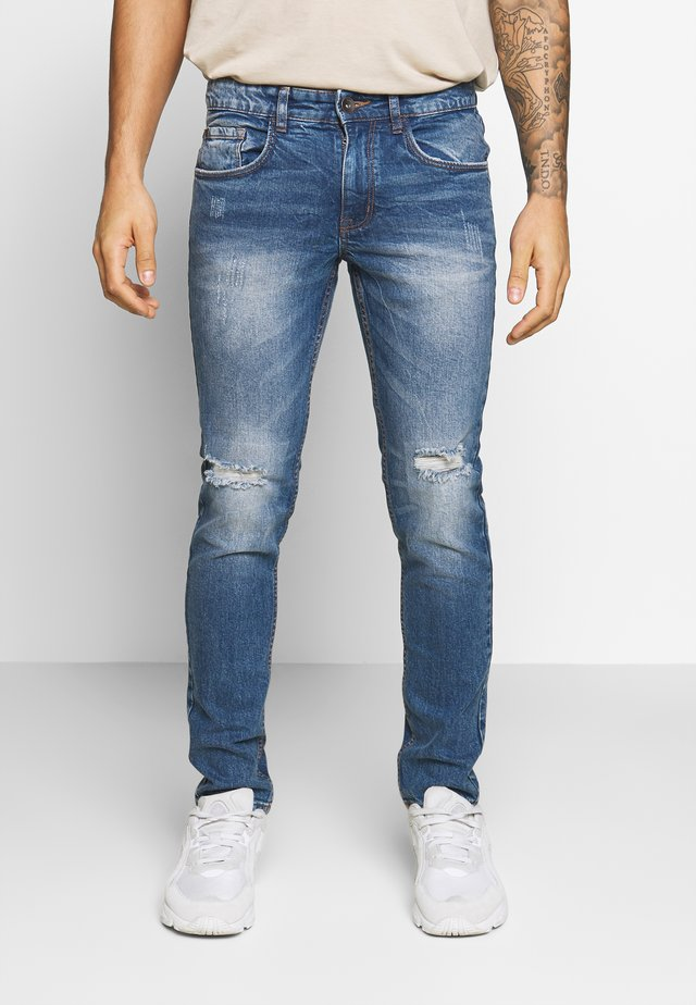 RRSTOCKHOLM DESTROY - Jeans Skinny Fit - perfect indigo