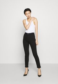 rag & bone - NINA HIGH RISE ANKLE CROP - Jeans Skinny Fit - black - 1